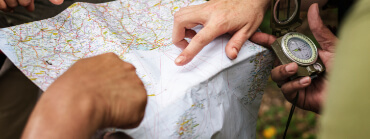 Photo Two Hands showing Details on a Map